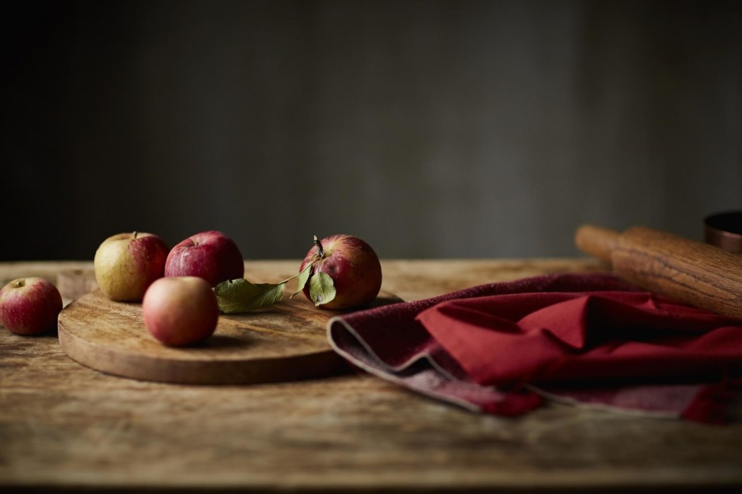 Apple on a wooden table and plate