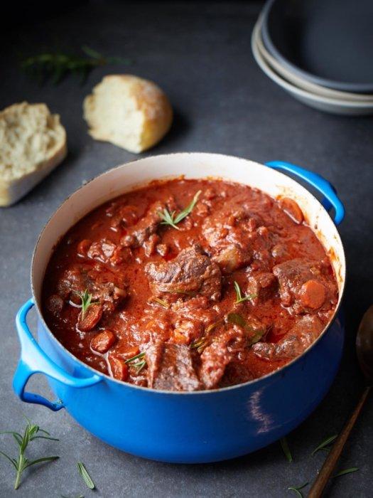A stew in a blue dutch oven