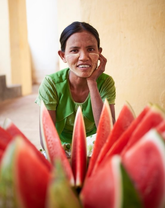 Travel photo of a woman with watermelons
