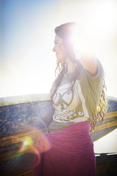Lifestyle shot of woman surfer - lifestyle photography