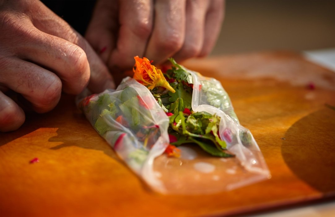 Raw fresh spring roll being rolled