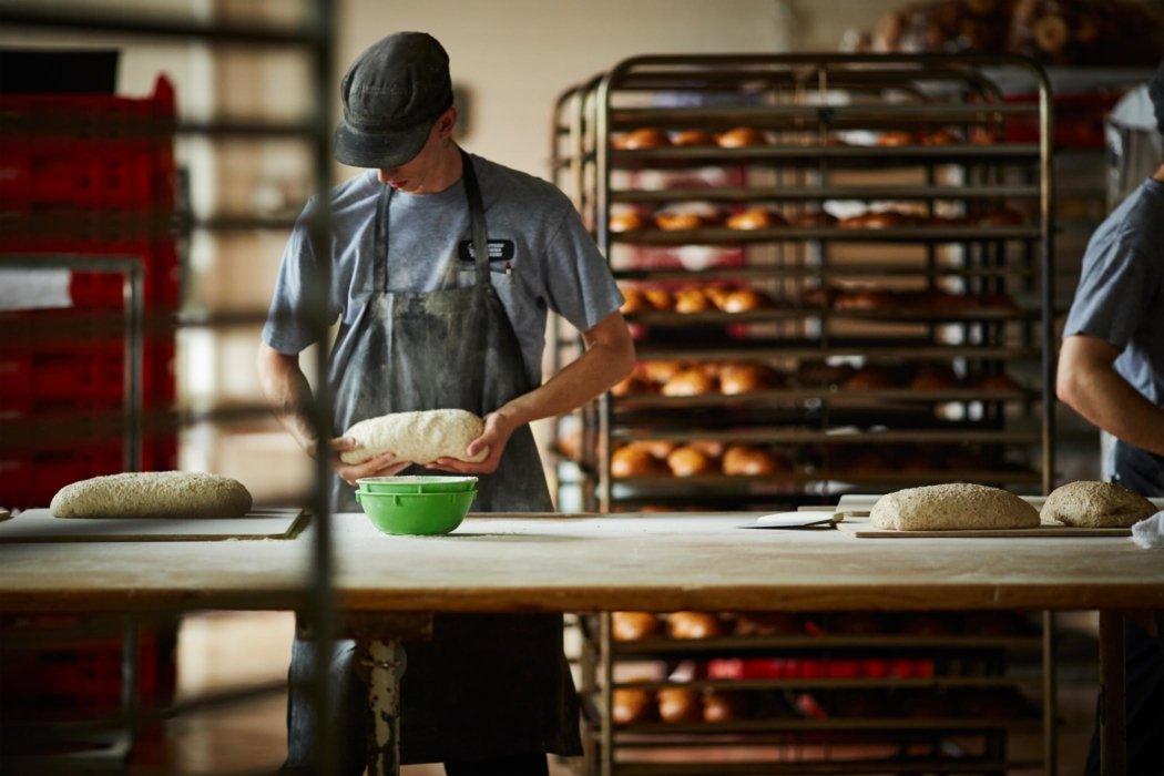 Bakers preparing bread dough
