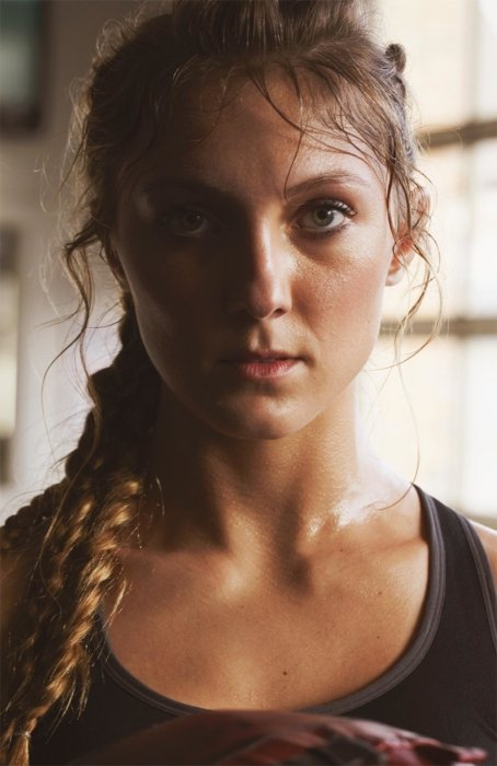 Portrait of female athlete sweating after workout