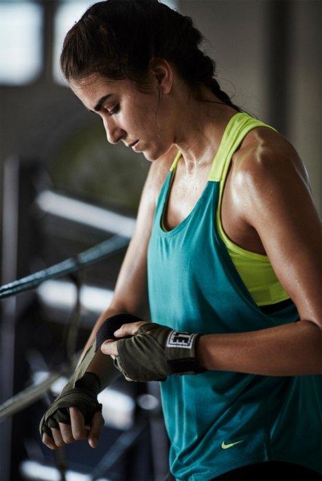 Female athlete wearing blue nike athletic gear