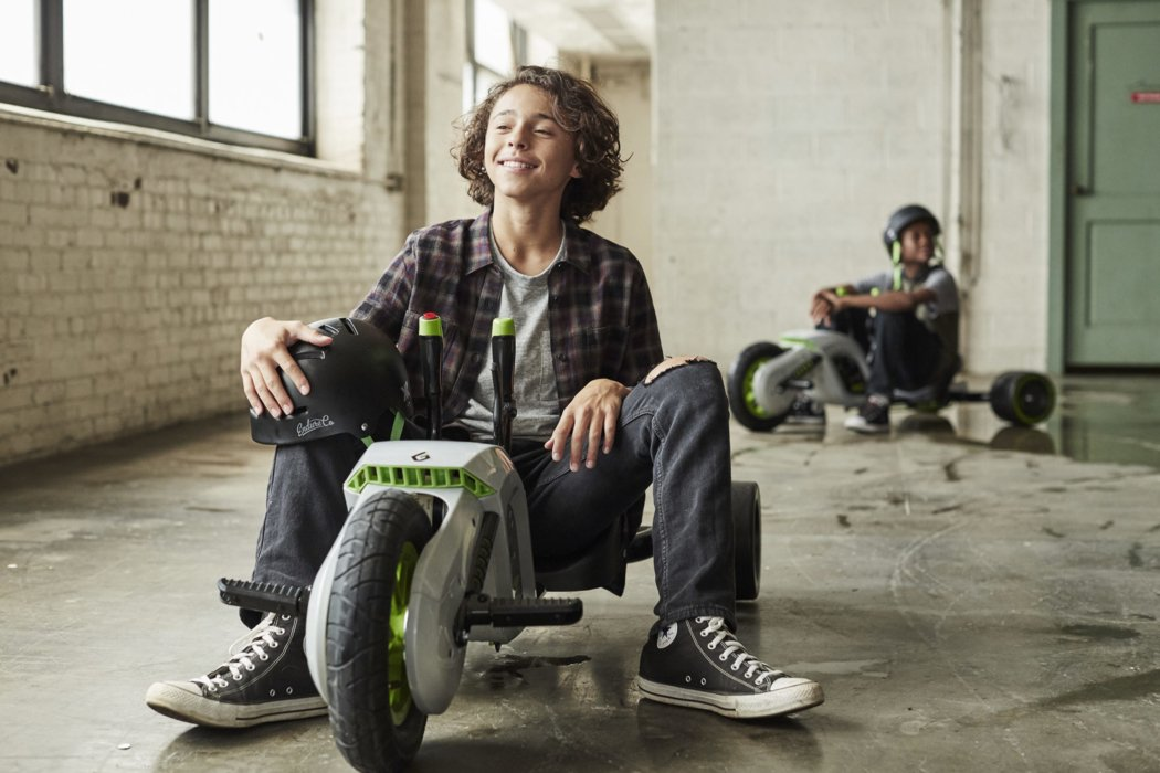 Kids on low riding bike - lifestyle photography