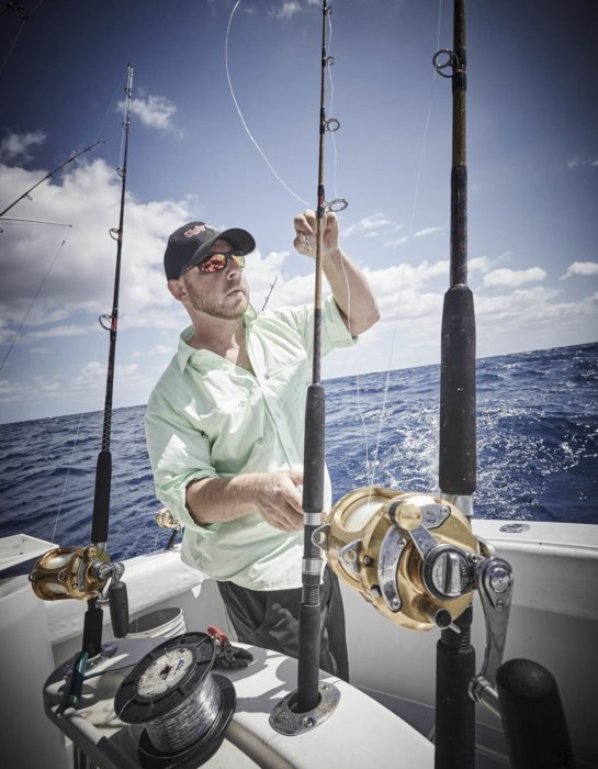 A fisherman with a fishing pole - ugly stick ocean rods