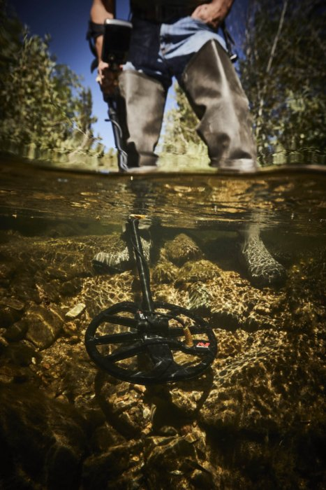 Metal detector in a shallow stream