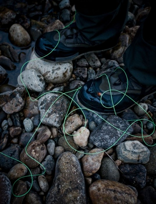 Fly fishing string products on a rock