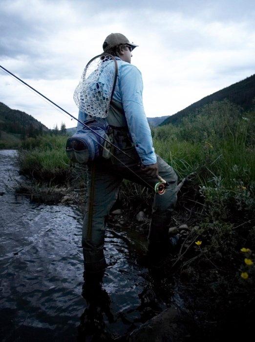 Man carrying a fishing rod