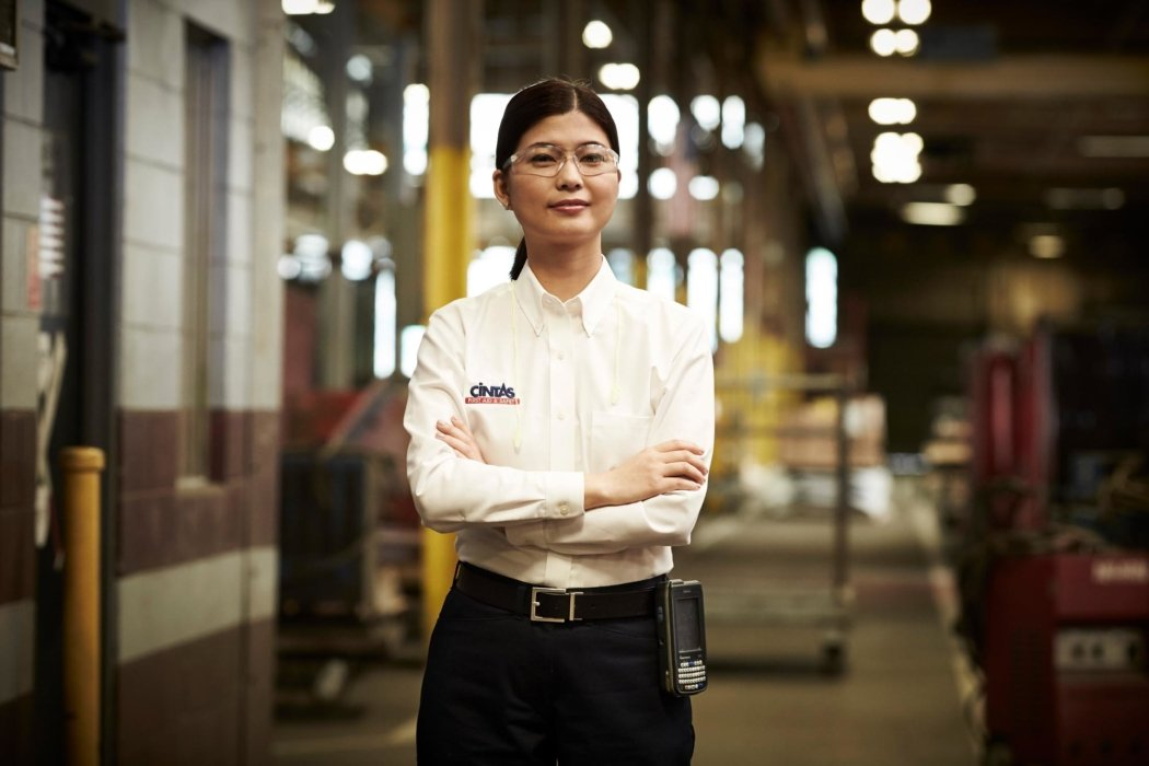A hero portrait of a worker with arms crossed