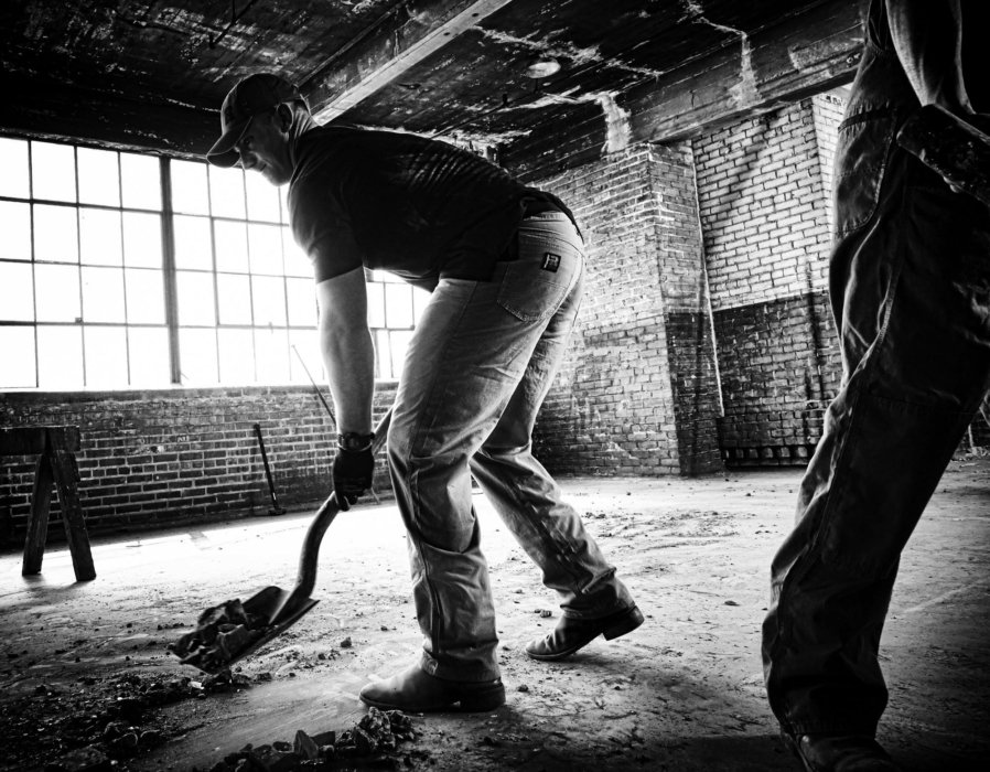 Men working in a old facility