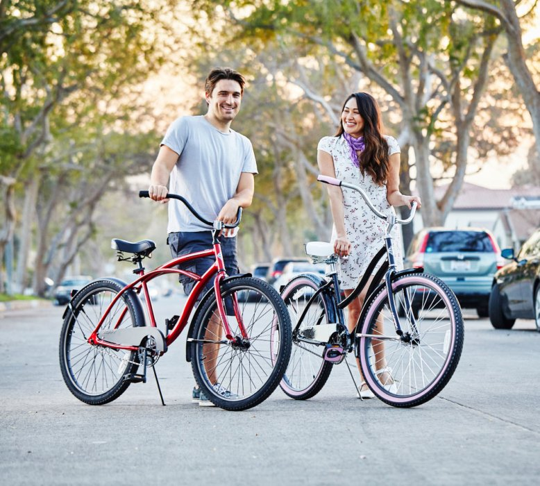 A couple with two bike on a street