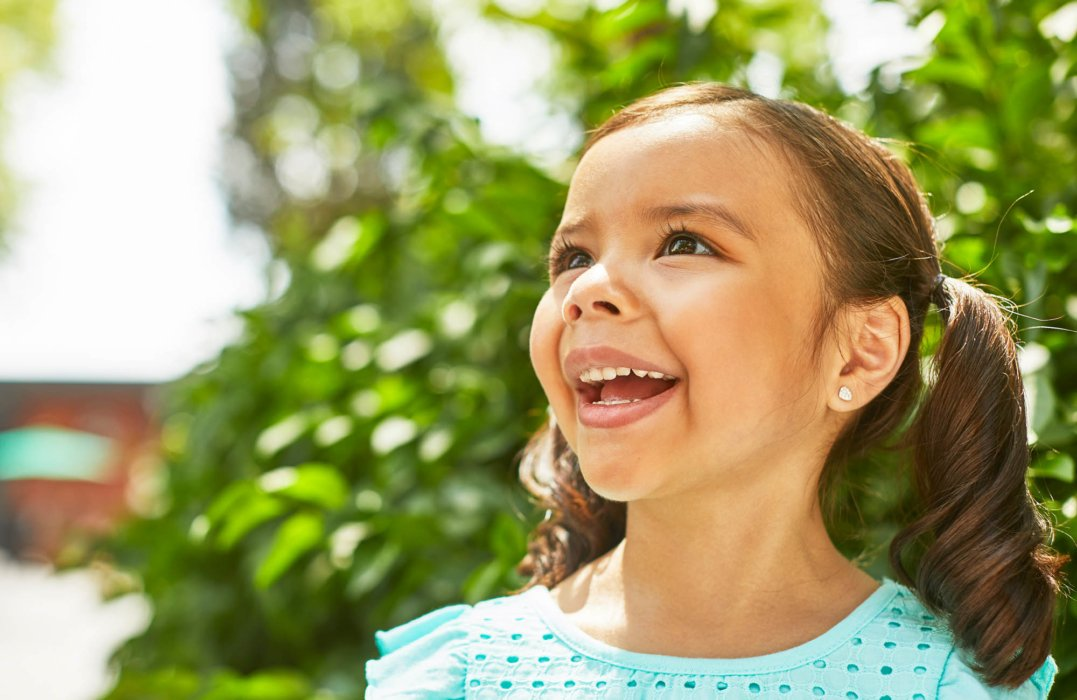 A young girl smiling on a happy sunny day - lifestyle photography