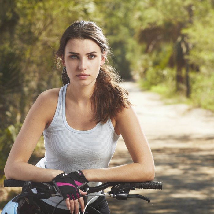 A portrait of an athletic woman on a bike