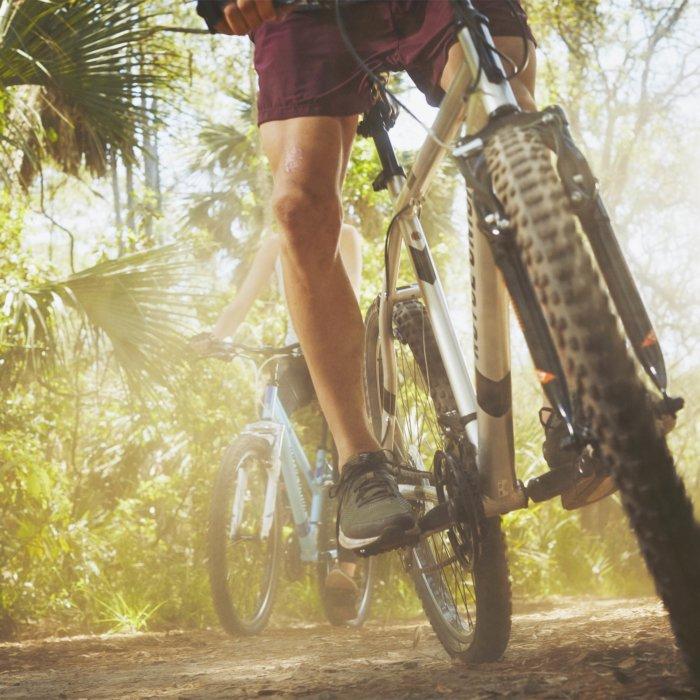 Two athletes riding on bikes