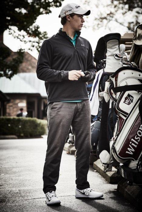 Athletic lifestyle of a golfer getting ready