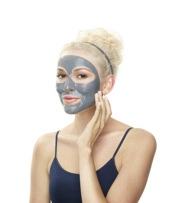 A woman applying a face mask