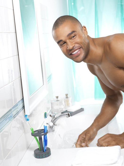 Beauty shot of a man at a bathroom sink