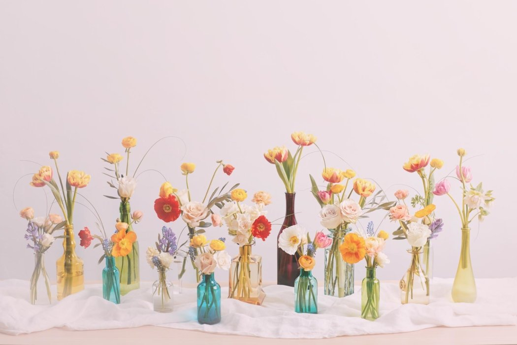 An arrangement of flowers and vases