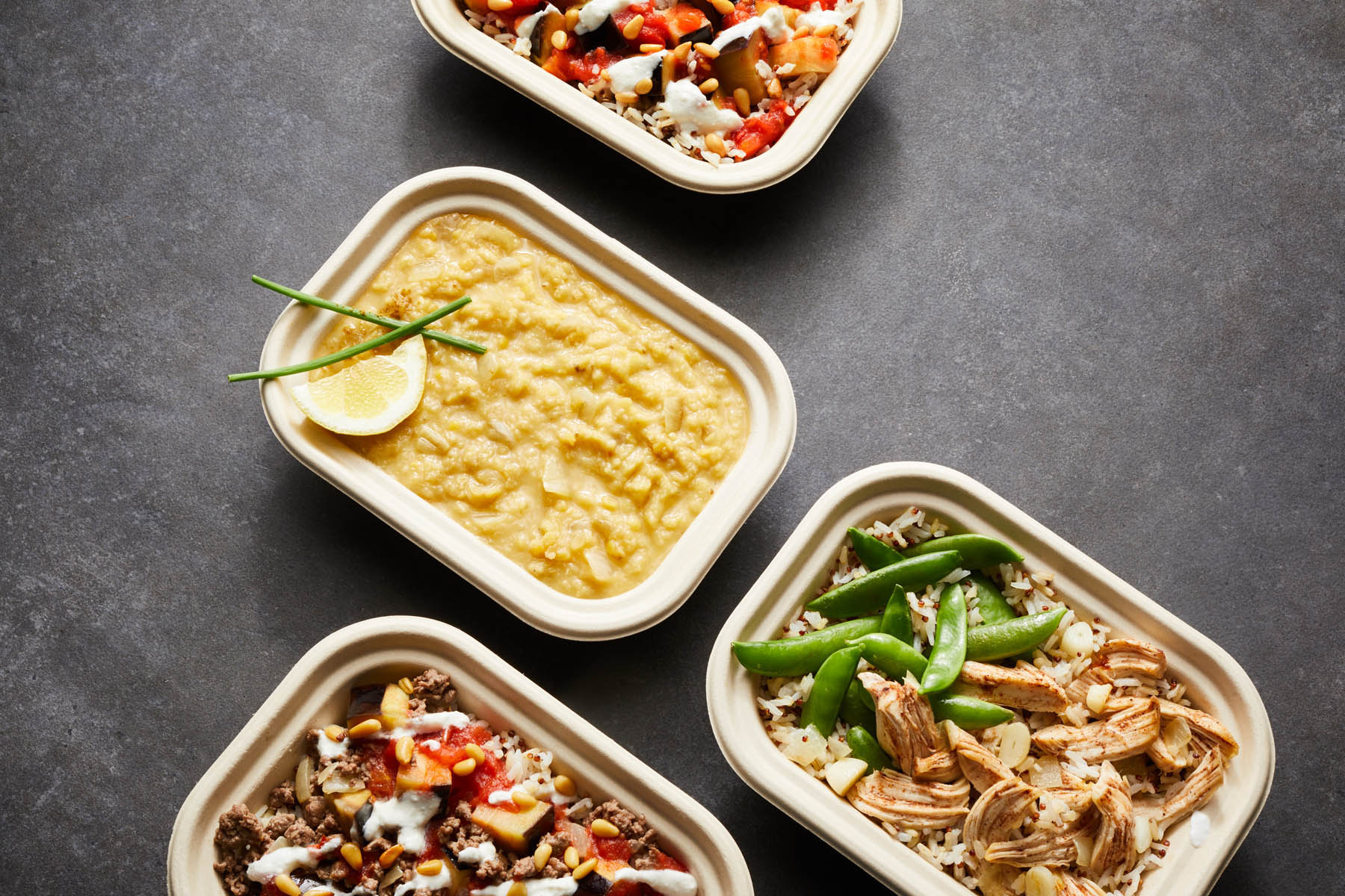 An arrangement of Mediterranean food top down angled
