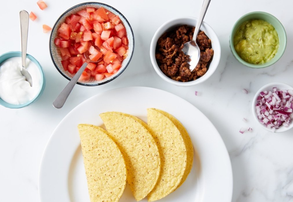 Putting together tacos and ingredients