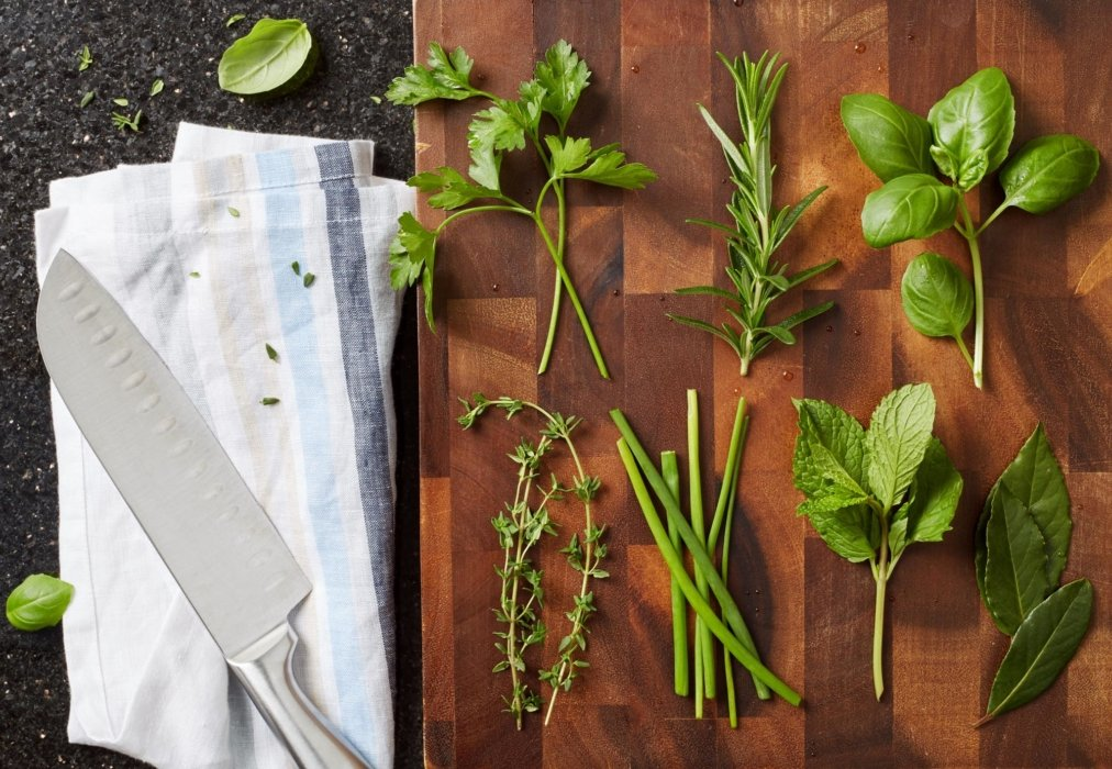 A cutting board with herbs