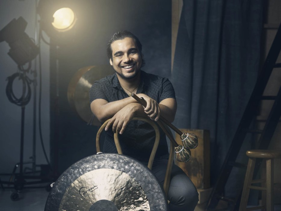 Portrait of a percussion musician with cymbals
