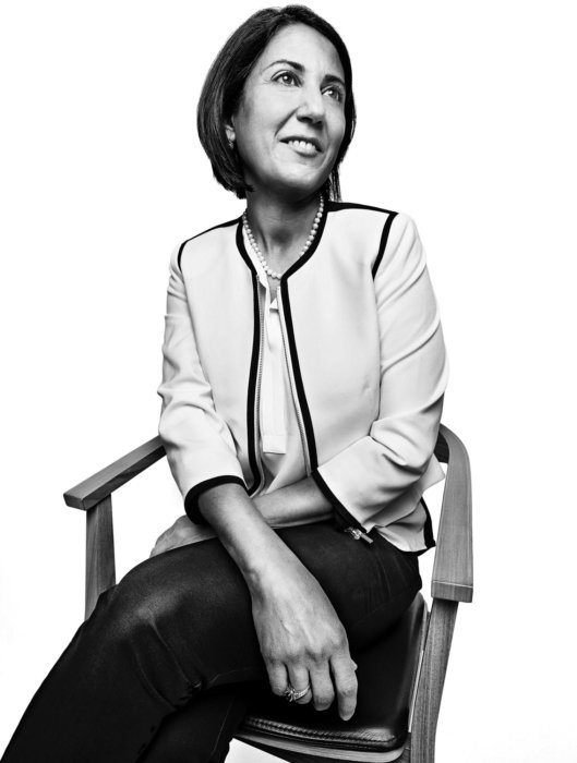A corporate woman's portrait sitting in chair