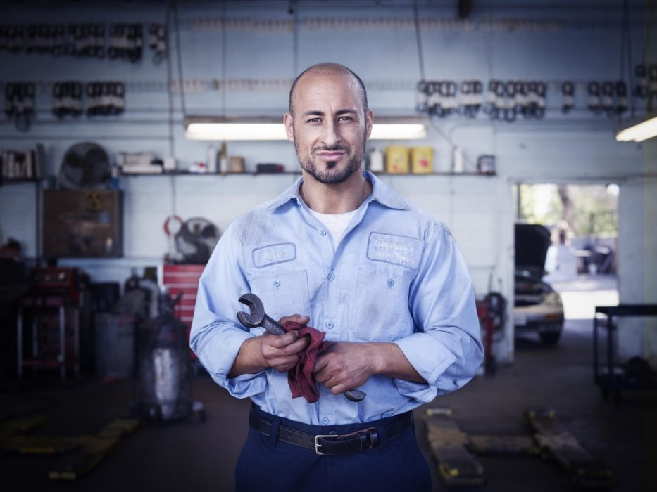 Portrait of a blue collar male worker holding a wrench