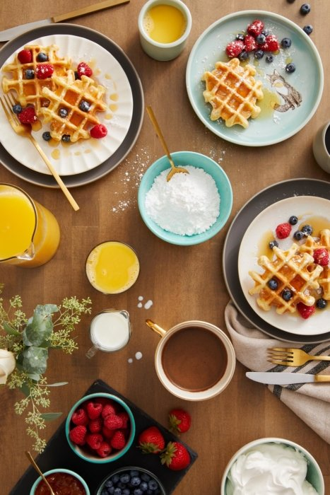 A breakfast spread with waffles