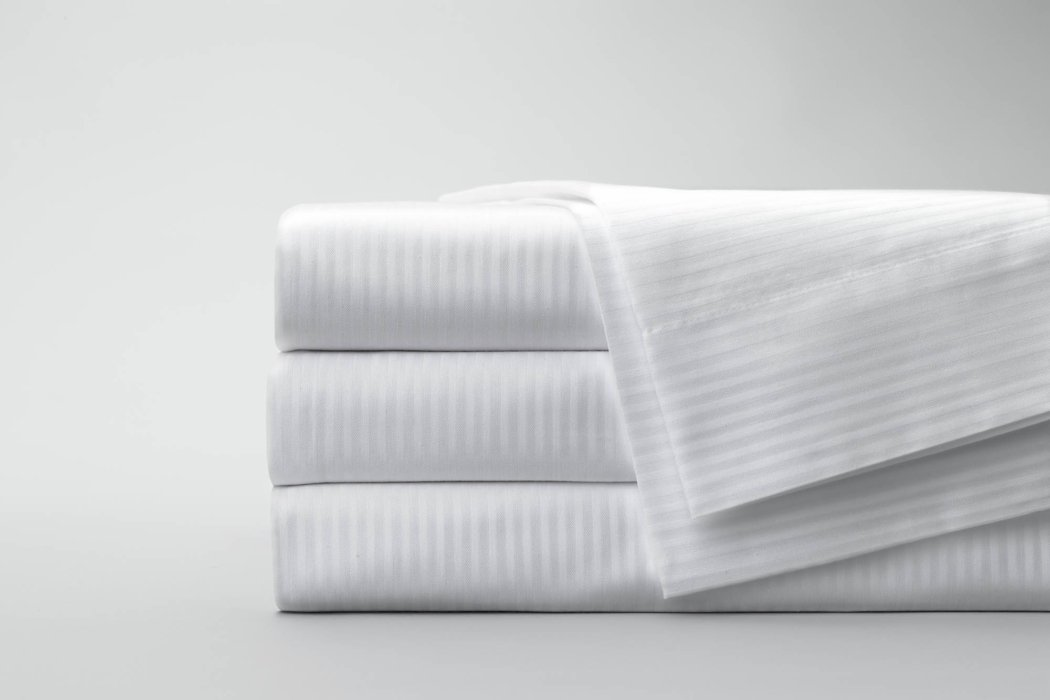 Folded stack of white textile fabrics