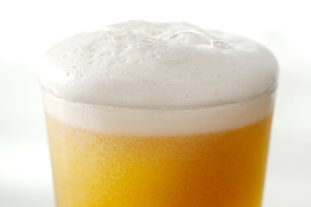 Beer frothy and head in a glass