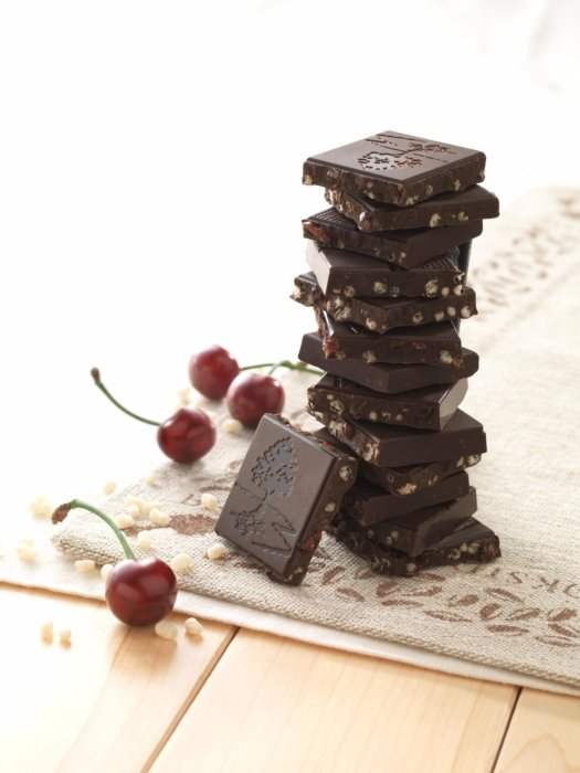 A stack of chocolate with cherries and nuts