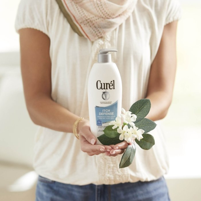 Curel - product and social media photography - woman holding lotion bottle