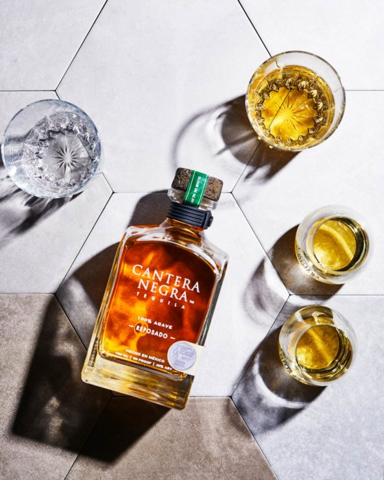 Tequila flat lay with reposado tequila in glasses - drink photography