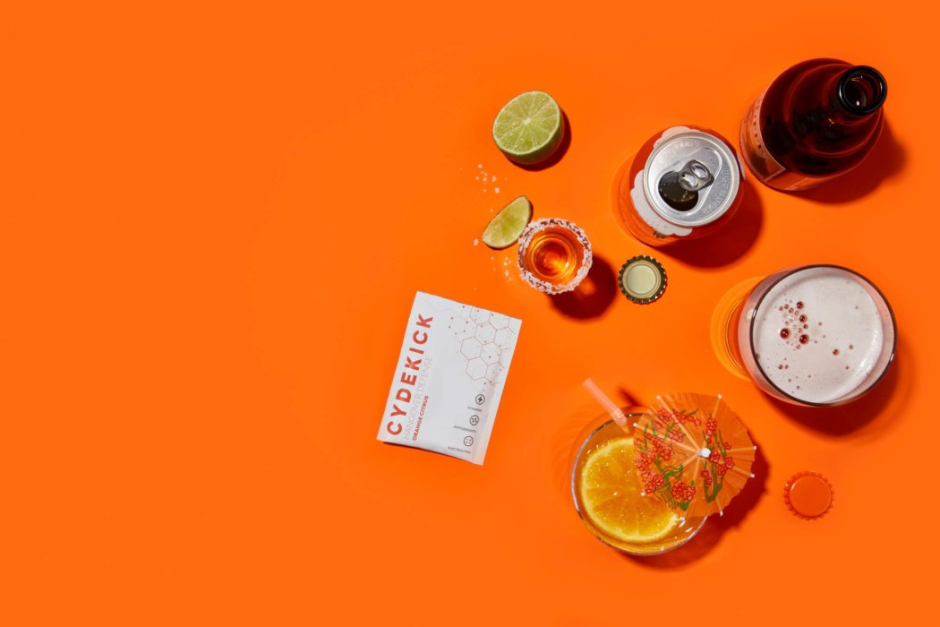 looking dowing cydekick packet with drinks product photography