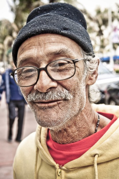 Portrait of an older man man close up on the street