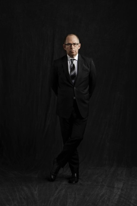 Portrait of a Michael Bierut on a dark cloth background