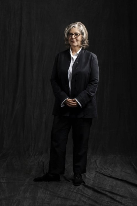 Portrait of Maira Kalman on a dark cloth background