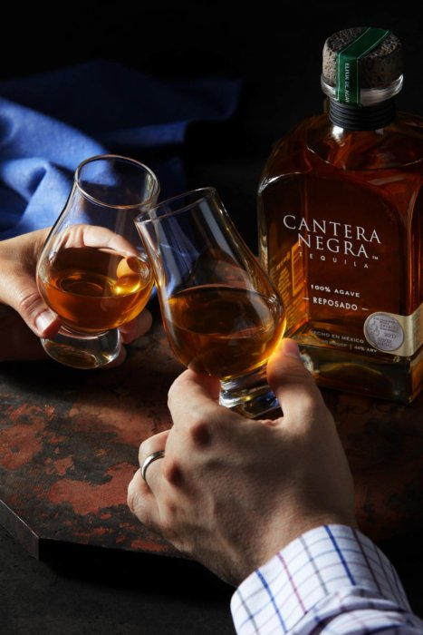 Two people cheers - tequila - canter negra - drink photography