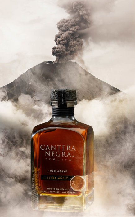 Tequila bottle coming from a smoking volcano - canter negra - drink photography