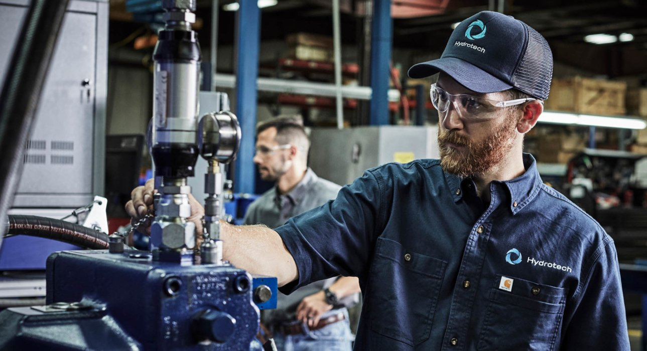 Men working on industrial equipment inspections - - industrial photography
