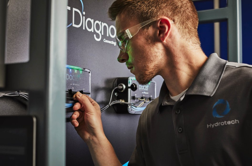 A man with safety glasses inspecting industrial equipment - industrial photography