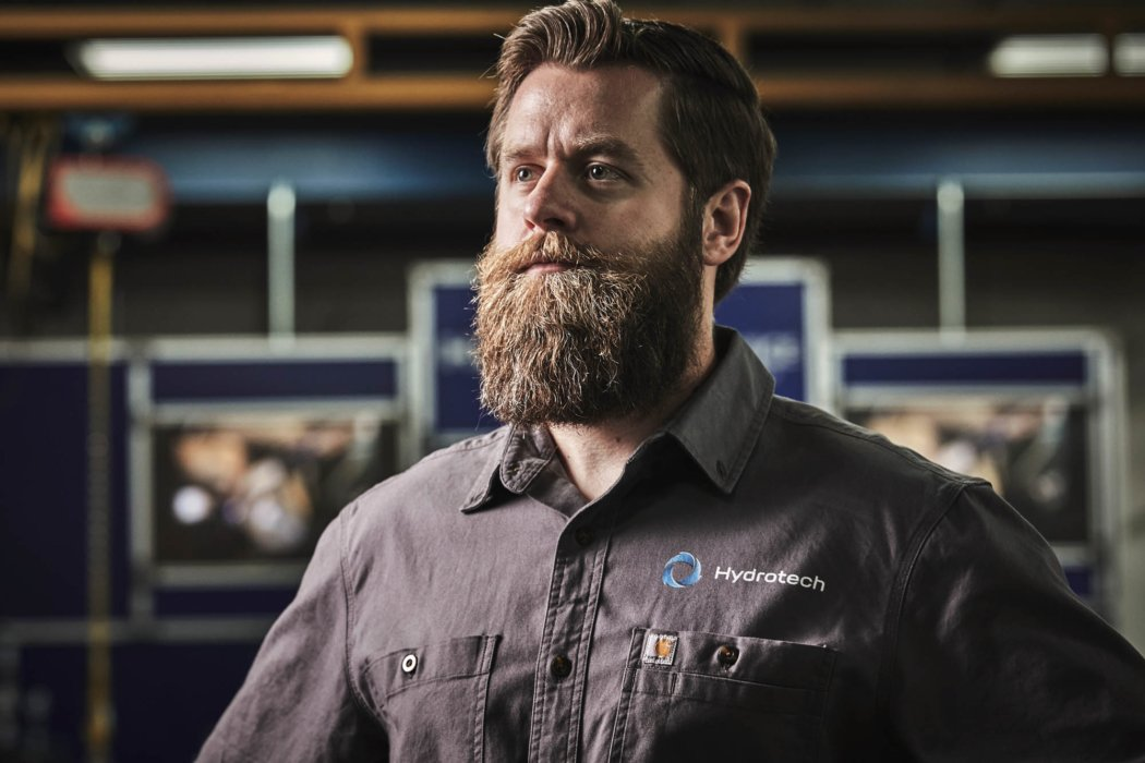 Man with beard in Hydrotech suit workplace photographer