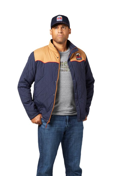 A male model for an ecommerce photo of a rural cloth vest blue - apparel photography