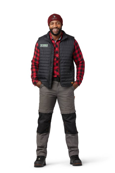 A male model wearing a hat vest pants - ecommerce apparel photography