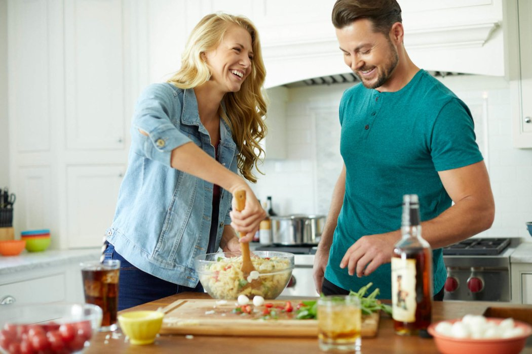 A couple making pasta salad for a part - blackheart rum - lifestyle drink photography