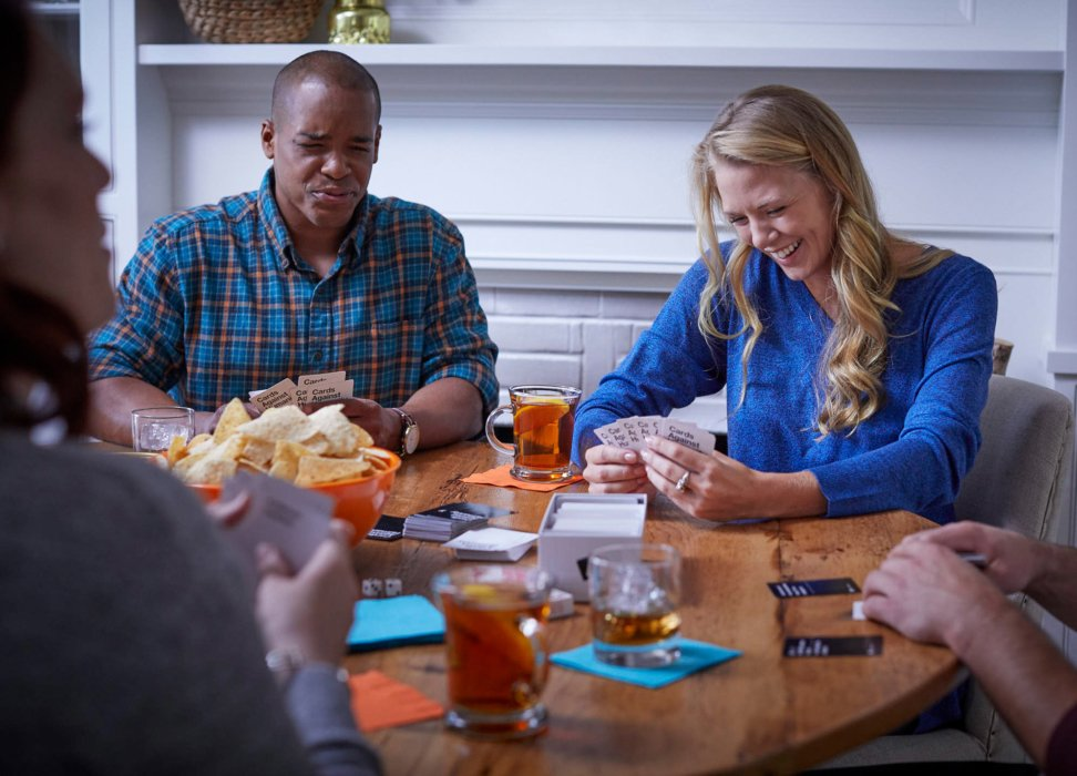 A group of people playing games at a party with blackheart rum alternate - lifestyle drink photography