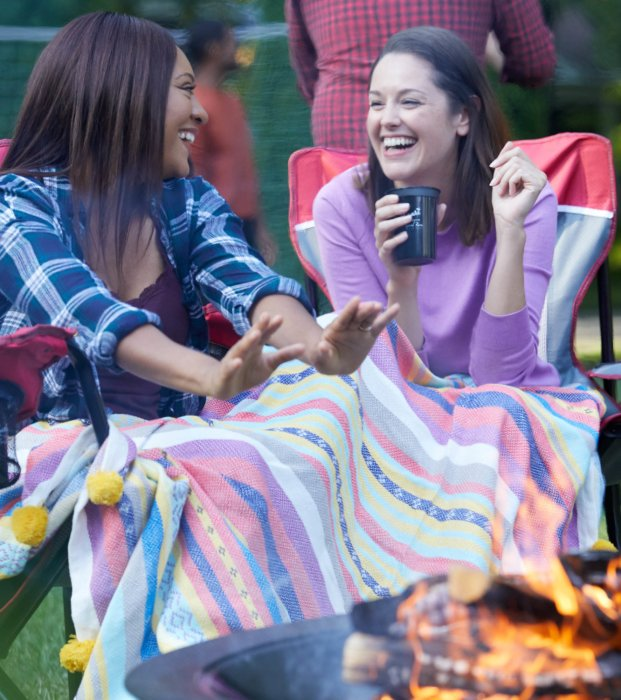 Girls by a bon fire drinking blackheart rum - lifestyle drink photography