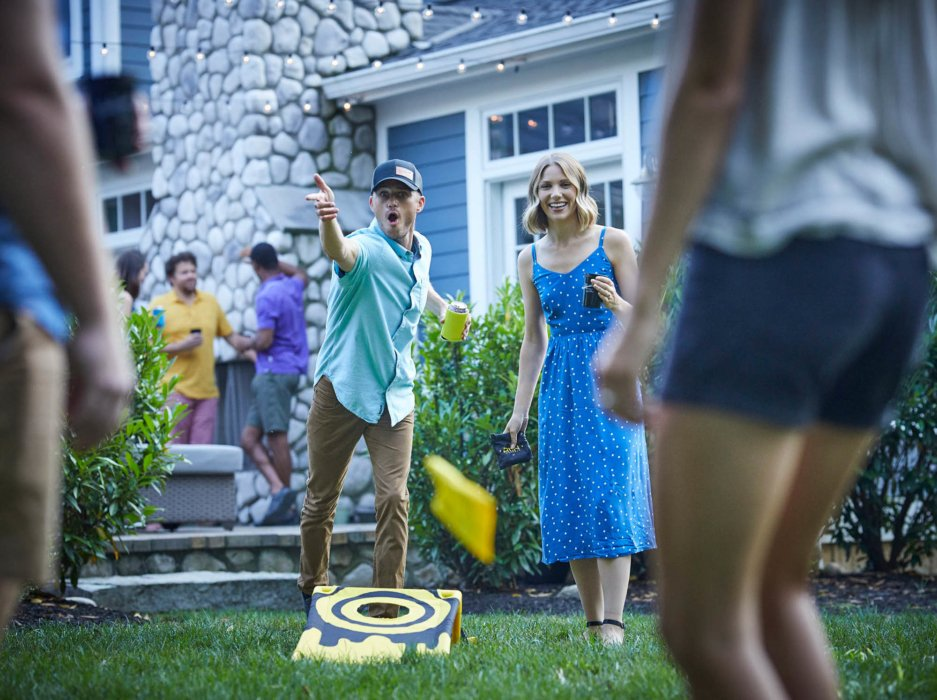 A game of cornhole at a drinking party - lifestyle drink photography